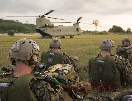 U.S. Marines with Echo Company, 4th Reconnaissance Battalion, 4th Marine Division, Marine Forces Reserve, stand by to conduct high altitude, high opening (HAHO) jump operations out the back of an U.S. Army Boeing CH-47 Chinook at Camp Grayling Joint Maneuver Training Center, Michigan, during exercise Northern Strike 17, Aug. 2, 2017. ( Lance Cpl. Niles Lee/ Marine Corps)