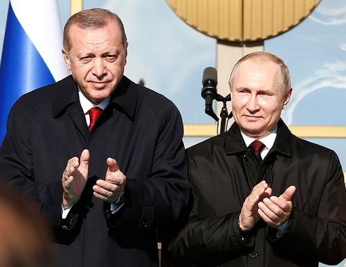 In this April 3, 2018, file photo, Turkey's President Recep Tayyip Erdogan left, and Russia's President Vladimir Putin, right, applaud during a welcome ceremony prior to their meeting at the Presidential Palace in Ankara, Turkey. (Burhan Ozbilici/AP)