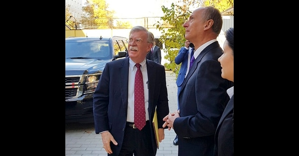 U.S. National Security Adviser John Bolton, left, and Russian Security Council chairman Nikolai Patrushev speak prior their official talks in Moscow on Monday, Oct. 22, 2018. Bolton met with Patrushev to discuss a broad range of issues including arms control agreements, Syria, Iran, North Korea and the fight against terrorism. (Press Service of the Russian Security Council via AP)