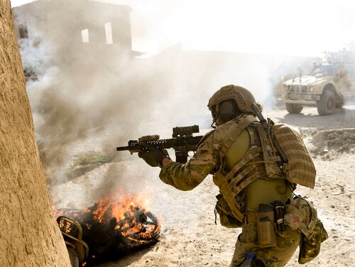 A U.S. Special Operations soldier returns fire while conducting multi-day Afghan-led offensive operations against the Taliban in Mohammad Agha district, Logar Province, Afghanistan, July 28, 2018. (Staff Sgt. Nicholas Byers/ Air Force)