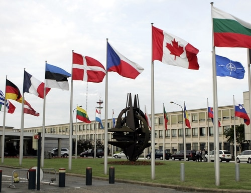 NATO member country flags are seen outside NATO headquarters in Brussels. (Virginia Mayo/AP)