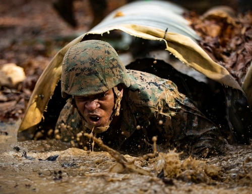 Marines from Corporals Course 615-20 with Combat Instructor Battalion go through the obstacle endurance course at Marine Corps Base Quantico, Quantico, Va., Feb. 7, 2020. (Cpl. Mikayla R. Perez/Marine Corps)