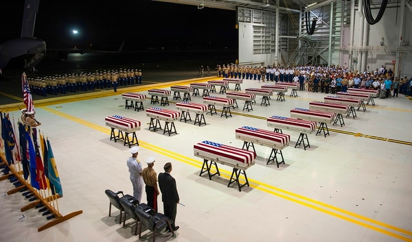 In this Wednesday, July 17, 2019, photo, service members and guests stand as