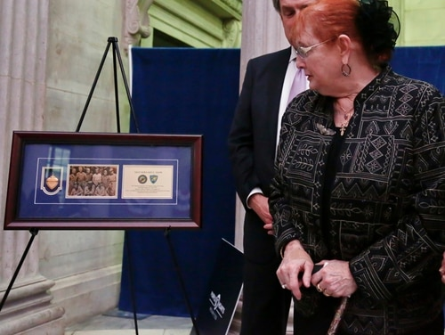 Rebecca Crofts, right, is given a previously lost Purple Heart belonging to her father, World War II Staff Sgt. Bernard Snow, during a ceremony reuniting families with previously lost Purple Hearts belonging to war veterans, on National Purple Heart Day, Monday Aug. 7, 2017, at Federal Hall in New York. (Bebeto Matthews/AP)
