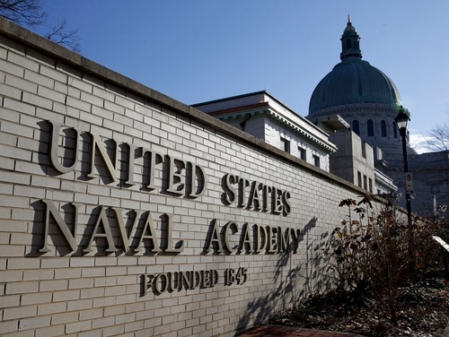 A sign stands outside of an entrance to the U.S. Naval Academy campus in Annapolis, Md., on Jan. 9, 2014. (Patrick Semansky/AP)