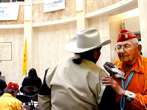In this Feb. 4, 2011, file photo, Leland Anthony, Arizona Rep. for Indian Health Incorp., left, speaks with Navajo code talker Joe Vandever Sr. during Native American Day at the roundhouse in Santa Fe, New Mexico. (Jane Phillips/The New Mexican via AP)