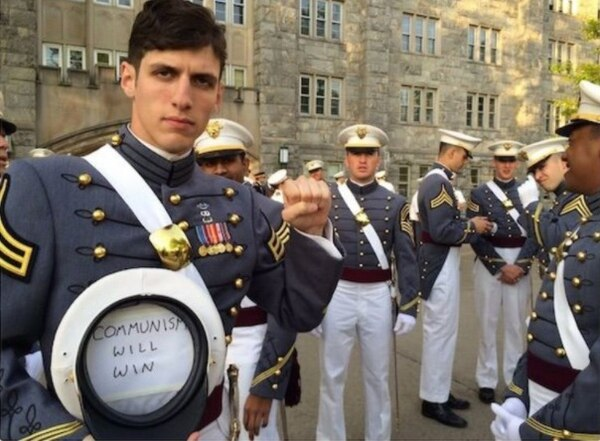 2nd. Lt. Spenser Rapone is under investigation after tweeting photos of himself support communism while in uniform. (Source: Twitter)