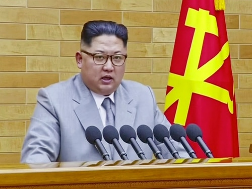 In this image made from video released by KRT on Jan. 1, 2018, North Korean leader Kim Jong Un speaks in his annual address in undisclosed location, North Korea. (KRT via AP Video)