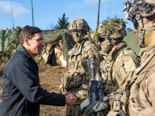 Army Secretary Mark Esper talks to soldiers during a troop visit to Europe. (John Martinez/Army)