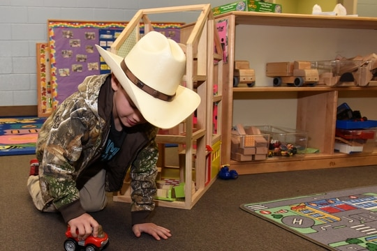 A child plays with a toy truck at the child development center on Goodfellow Air Force Base, Texas, in 2019. (Airman 1st Class Abbey Rieves/Air Force)