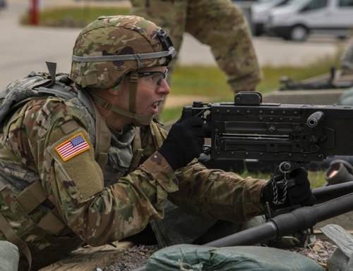 Army Reserve Sgt. Keith Mundorff, a civil affairs specialist representing the Civil Affairs & Psychological Operations Command (Airborne), fires an M2 machine gun Sept. 7 for a timed weapons qualification test during the 2020 U.S. Army Reserve Best Warrior Competition at Fort McCoy, Wisconsin. 7. (Spc. Olivia Cowart/Army Reserve)