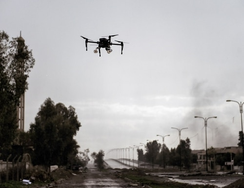 Iraqi forces test-fly a drone carrying two grenades. They aimed to use the drone against Islamic State fighters, who used small drones to drop explosives on advancing Iraqi forces. (Aris Messinis/AFP via Getty Images)