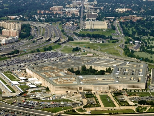 Aerial of the Pentagon, the Department of Defense headquarters in Arlington, Virginia, near Washington, with I-395 freeway on the left, and the Air Force Memorial up middle.
