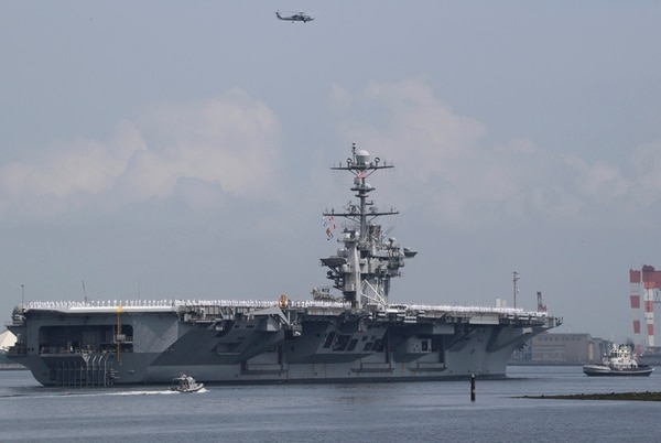 USS George Washington leaves the U.S. Navy's Yokosuka base in Yokosuka, near Tokyo Monday, May 18, 2015. The U.S. Navy's Japan-based aircraft carrier is heading home after seven years, to be replaced by a newer version of the same ship in the fall. (AP Photo/Koji Sasahara)