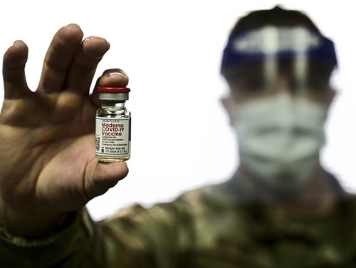 Tech.  Sgt.  Joseph Anthony of the 911th Airborne Division Squadron holds a vial of COVID-19 vaccine at Pittsburgh International Airport, Pennsylvania Reservation Station, February 4, 2021 (Joshua J. Seibert / BBC)