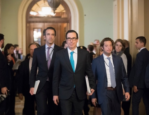 Treasury Secretary Steven Mnuchin arrives at the Capitol for a closed-door meeting with Senate Majority Leader Mitch McConnell, R-Ky, as they struggle to get a tax code overhaul, in Washington, Tuesday, Sept. 12, 2017. The as-yet-undrafted bill to overhaul the tax code is the top priority for Trump and Republicans after the collapse of their effort to dismantle Barack Obama's health care law. (J. Scott Applewhite/AP)
