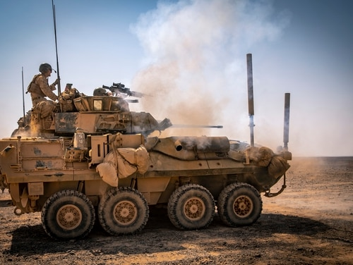 A light armored vehicle 25 fires its main gun during Exercise Eager Lion 19. Marine Corps leaders have decided the aging vehicle's replacement may not be another vehicle. (Sgt. Adam Dublinske/Marine Corps)