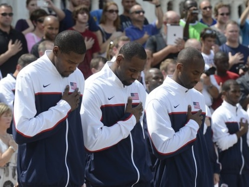 Kevin Durant, LeBron James and Kobe Bryant render honors at the of the Tomb of the Unknown Solider in Arlington National Cemetery, July 15, 2012. (DOD photo by D. Myles Culle)