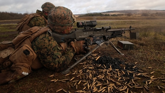 U.S. Marine with Special Purpose Marine Air-Ground Task Force- Crisis Response- Africa 19.1 fire a M240B machine gun during an attack on a live-fire range in Baumholder, Germany. (Cpl. Bethanie Ryan/Marine Corps)