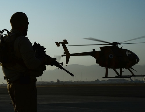 A U.S. Army Train, Advise, Assist Command – Air (TAAC-Air) personal security detail shift lead, provides over-watch while an MD-530 Cayuse Warrior, or 'Jengi' in Dari, takes off with an all-Afghan crew for a combat mission in September 2015. (Staff Sgt. Sandra Welch/Air Force)