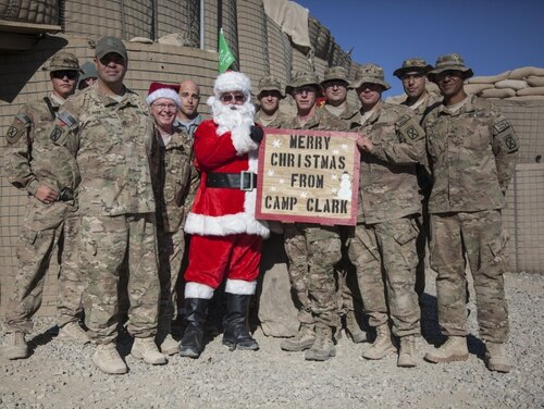 U.S. soldiers and Santa at Forward Operating Base Clark, Afghanistan, in 2013. (Army)