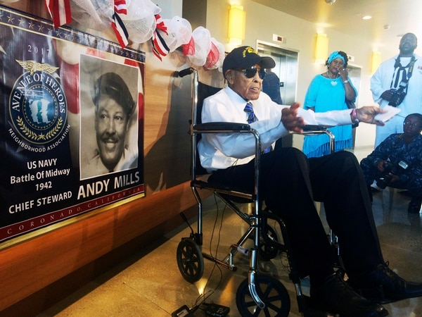 Former Navy Chief Steward Andy Mills, 102, talks to reporters before Navy officials hold a ceremony to name a new barracks after him, a rare honor for a living recipient, at Naval Base Coronado, Calif., Thursday, Aug. 10, 2017. Mills was one of the maritime branch's first black chiefs, who retrieved important documents on a sinking U.S. ship bombed by the Japanese. (Julie Watson/AP)