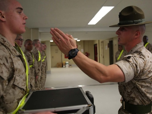 The most boot Marine recruit gets served his first of what will be many knife hands over the course of his enlistment. (Marine Corps)
