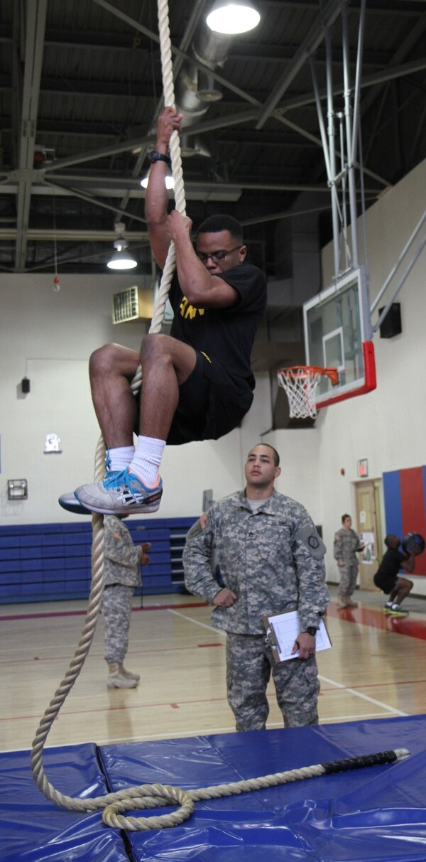 Pfc. Darryl H. Jenkins, G-6 automated information system technician for 19th Expeditionary Sustainment Command, climbs down the rope during the functional fitness test course portion of the Best Warrior Competition 2015 at Camp Walker's Kelly Gym April 16.