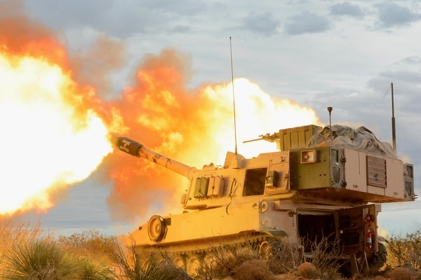 An M109 Paladin gun crew with 4th Battalion, 1st Field Artillery Regiment, Division Artillery at Fort Bliss, Texas, fires into the mountains of Oro Grande Range Complex, New Mexico, Feb. 14, 2018. (Spc. Gabrielle Weaver/Army)