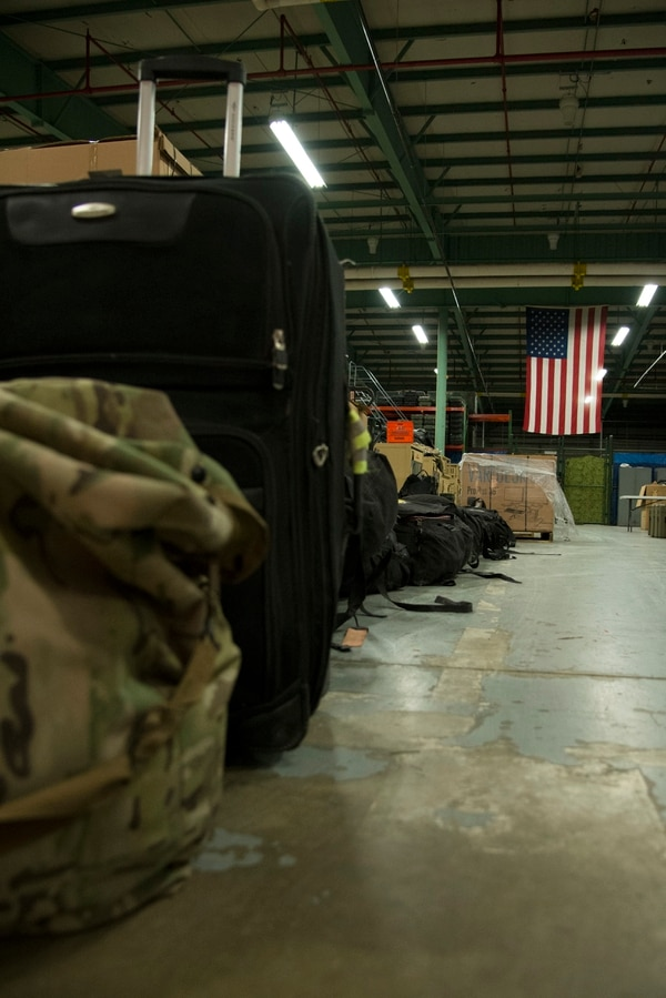 Luggage belonging to 12 returning 436th Security Forces Squadron defenders rests in a warehouse after a six-month deployment to the Middle East, Jan. 21, 2018, at Dover Air Force Base, Del. Families and unit members met the defenders upon their return. (Staff Sgt. Aaron J. Jenne/Air Force)