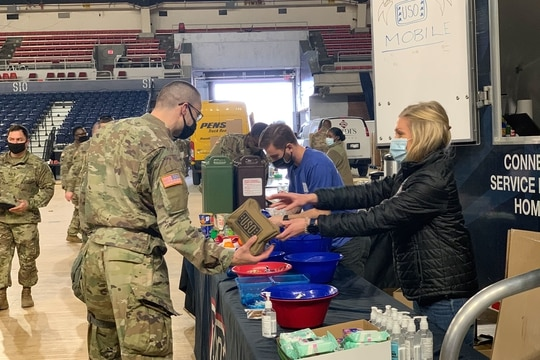 USO mobile units are providing snacks, drinks and care packs for National Guard troops deployed to the U.S. Capitol in advance of the Inauguration. The USO is a not-for-profit organization and not part of the Department of Defense. (USO staff)