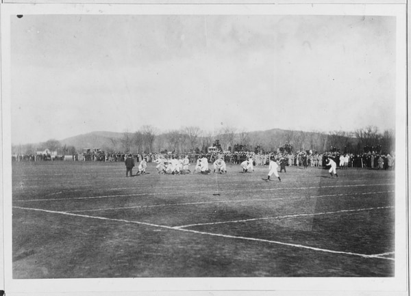 This is believed to be a photograph of the first Army-Navy game. Note the military coats of the spectators in the background. U.S. Naval Academy records show that no other military school was played in 1890. The final score in Annapolis was Navy 24, Army 0. (U.S. Naval History and Heritage Command)