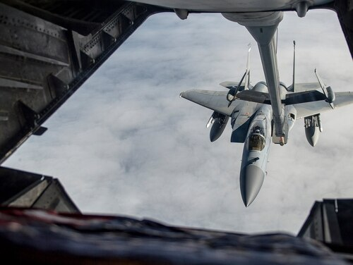 Airmen use a U.S. Air Force KC-10 Extender to refuel an F-15C Eagle as part of exercise Northern Edge in May 2019 at Joint Base Elmendorf-Richardson, Alaska. (Master Sgt. Nathan Lipscomb/Air Force)