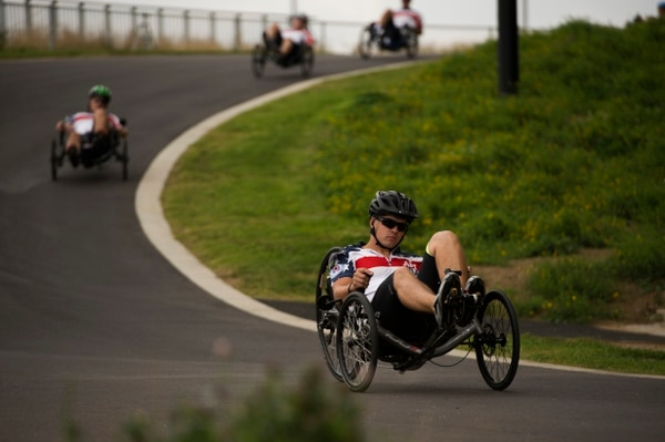 U.S. Marine Cpl. Dustin Gabehart competes in road cycling during the Invictus Games at the Lee Valley Velo Park, Queen Elizabeth Olympic Park, London, England, Sept. 13, 2014. Road Cycling is one of several sports over 300 wounded warriors from 13 nations might get to compete in including archery, wheelchair rugby, wheelchair basketball, indoor rowing, athletics, swimming and sitting volleyball. The vision for the Invictus Games is to harness the power of sport to inspire recovery, support rehabilitation and generate a wider understanding and respect for those who serve their country. (U.S. photo by Senior Airman Tiffany DeNault/released)