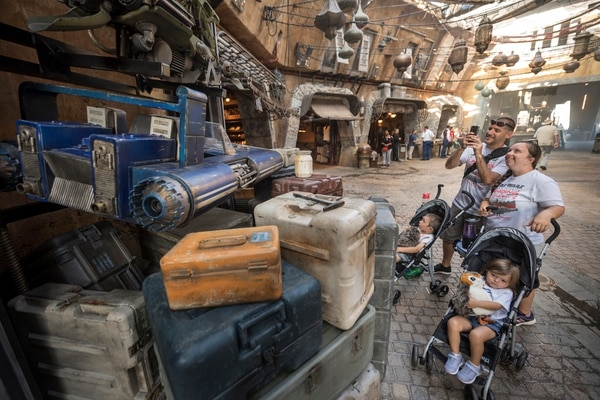 Coast Guard Petty Officer Second Class Karl Haslauer and his family visit The Black Spire Outpost marketplace inside Star Wars: Galaxy's Edge as part of a special advance preview of Star Wars: Galaxy's Edge before it officially opens.
