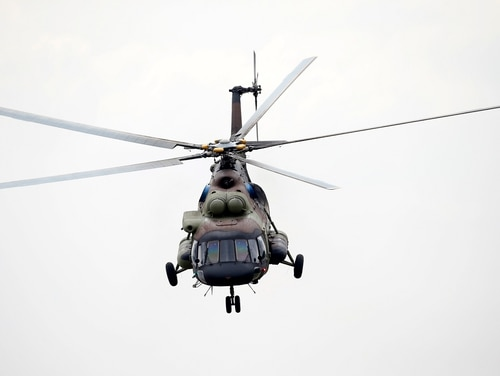 A Serbian Army Mi-171 helicopter performs during an exercise at a ceremony marking 72 years since the end of WWII, at Nikinci training ground, 60 kilometers west of Belgrade, Serbia. (Darko Vojinovic/AP)