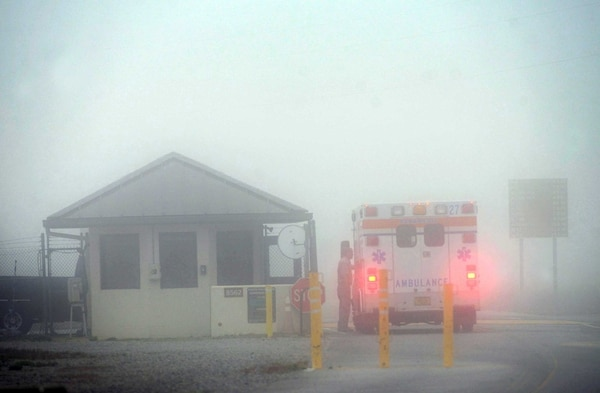 An Okaloosa County ambulance sits at the Eglin Air Force Base entrance, near Fort Walton Beach, Fla., Wednesday, March 11, 2015. Seven Marines and four soldiers aboard an Army helicopter that crashed over waters off Florida during a routine night training mission were presumed dead Wednesday, and crews found human remains despite heavy fog hampering search efforts, military officials said. (AP Photo/Northwest Daily News, Devon Ravine)