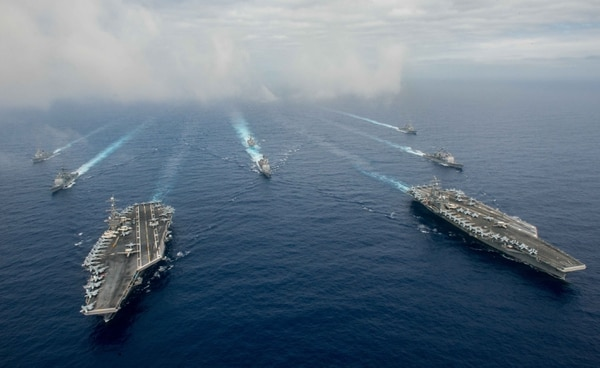 PHILIPPINE SEA - JUNE 18: In this handout provided by the U.S. Navy, The Nimitz-class aircraft carriers USS John C. Stennis (CVN 74) (L) and USS Ronald Reagan (CVN 76) conduct dual aircraft carrier strike group operations in the U.S. 7th Fleet area of operations in support of security and stability in the Indo-Asia-Pacific. (Photo by Specialist 3rd Class Jake Greenberg/U.S. Navy via Getty Images)