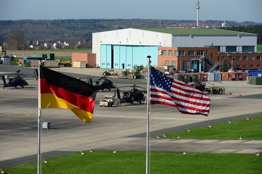 U.S. and German flags fly outside 12th Combat Aviation Brigade Headquarters overlooking the Katterbach Army Airfield in Ansbach, Germany, April 21, 2016. (Spc. Charles Rosemond/Army)