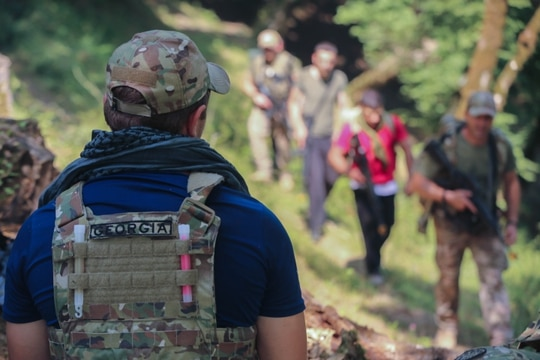 Georgian special operations forces and a notional Georgian guerrilla force navigate to an objective during the 10th Annual Agile Spirit Multinational Exercise in Senaki, Republic of Georgia, Aug. 1, 2021. A goal of Exercise Agile Spirit is to promote a whole-of-society approach to resistance. (Army/Spc. Preston Hammon)