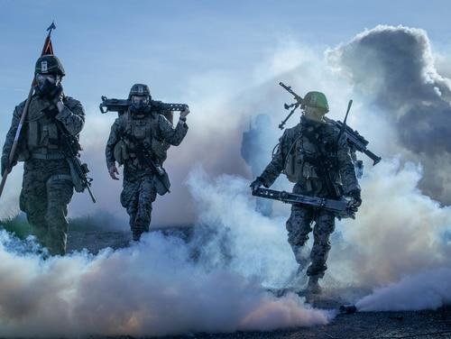 Marines from 1st Battalion, 1st Marine Regiment, 1st Marine Division, hike through a simulated chemical attack at Marine Corps Base, Camp Pendleton, California, Jan. 12. (Cpl. Rhita Daniel/Marine Corps)