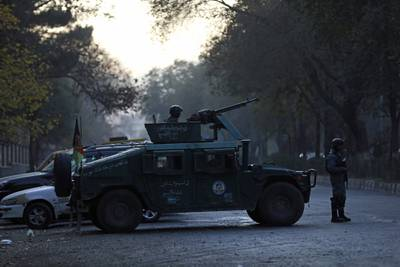 Afghan police patrol at the site of an attack at Kabul University in Kabul, Afghanistan, Monday, Nov. 2, 2020.
