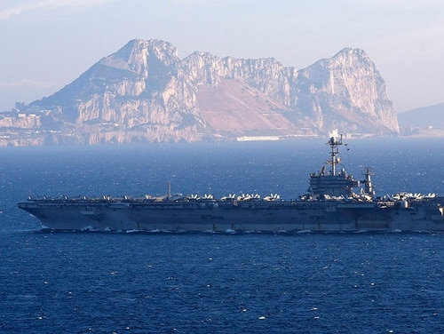 The carrier Harry S. Truman transits the Strait of Gibraltar. Harry S. Truman and its escorts are returning to Norfolk after just three months, a major break from the norm. (MC2 Thomas Gooley/U.S. Navy)
