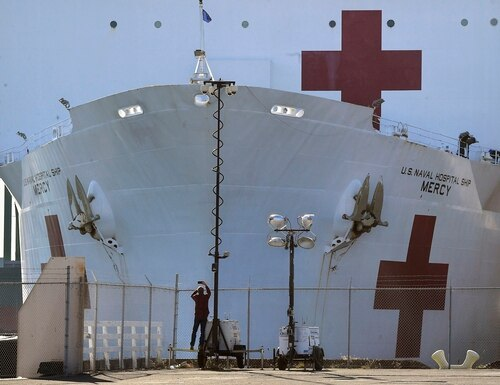 The USNS Mercy, seen here docked in Los Angeles, departed Friday for its home port of San Diego.(Mark J. Terrill/AP)