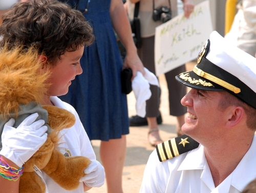 Then-Cmdr. Thomas R. Buchanan, the commanding officer of the Los Angeles-class attack submarine Albany, in 2010 greeting his son on the pier after returning to Naval Station Norfolk after a six-month deployment. Capt. Buchanan has been named 88th Commandant of the Midshipmen at the U.S. Naval Academy in Annapolis. (Navy)
