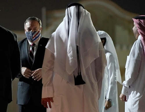 Secretary of State Mike Pompeo prepares to board a plane at Old Doha International Airport, Saturday, Nov. 21, 2020, in Doha, Qatar. Pompeo is en route to the United Arab Emirates. (Patrick Semansky/Pool via AP)
