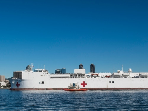 The hospital ship USNS Mercy, seen here in San Diego, has moved seven sailors off the ship who contracted COVID-19. (MCS Chelsea Troy Milburn/Navy)