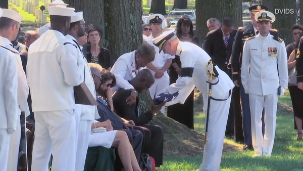Darrold Martin receives the flag at the funeral of his only son, Xavier Martin, one of the seven Fitzgerald sailors who drowned on June 17, 2017. (Navy)