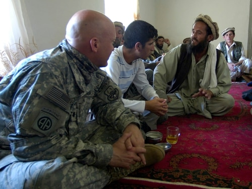 Air Force Lt. Col. Christopher Luedtke, left, listens to an Afghan interpreter relaying the requests of a local elder in Roydara on August 7, 2007. (Master Sgt. James Varhegyi/Air Force)