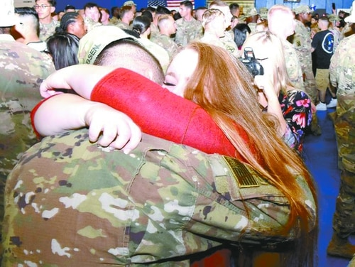 A soldier gets a welcome home hug from his wife at Fort Polk in 2018. (Chuck Cannon/Fort Polk)